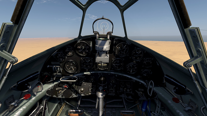 An in game screenshot of a Freccia from the pilots position showing the view and the instrument panel.