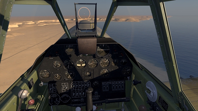An in game screenshot of a Kittyhawk from the pilot position showing the view and instrument panel.