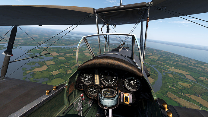 An in game screenshot of a Tiger Moth from the pilots position showing the view and instrument panel.
