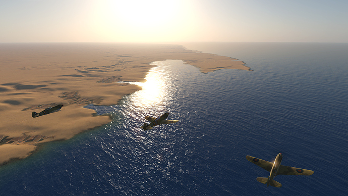 A screenshot of a flight of Spitfire fighters over the blue Mediterranean.