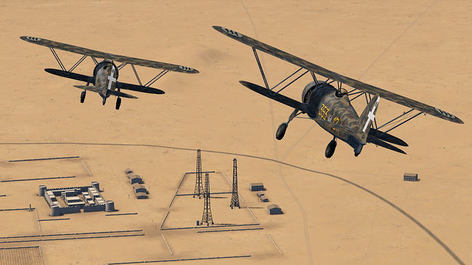 An in game screenshot of a pair of Falco, external from the back as they pass near a fort in the African desert.