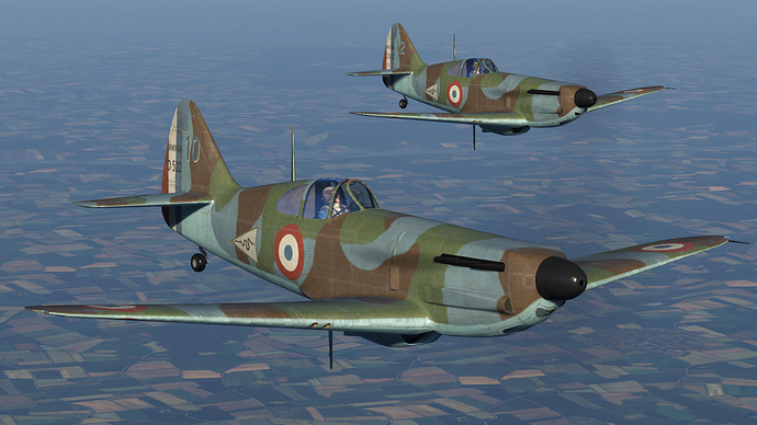 In game screenshot of a pair of D.520 fighers, external view.