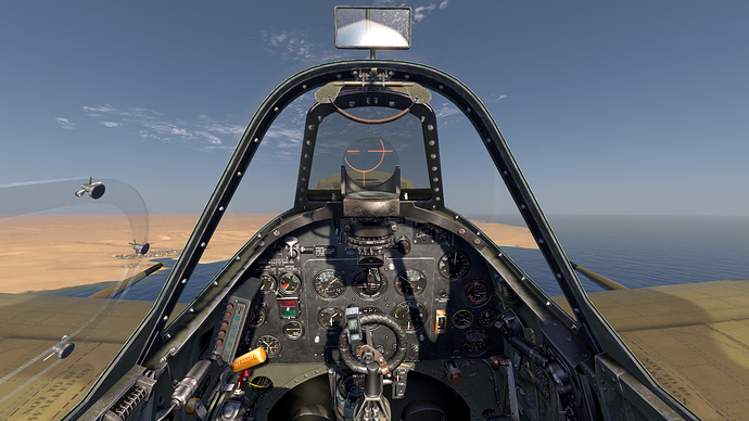 An in game screenshot of a Spitfire showing the pilot view and instrument panel.