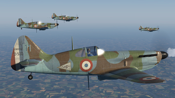 In game screenshot showing a flight of D.520 fighters.
