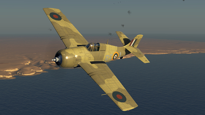 An in game screenshot of a Martlet, external in a left hand turn with the sun behind the viewer and the African cost in the distance.