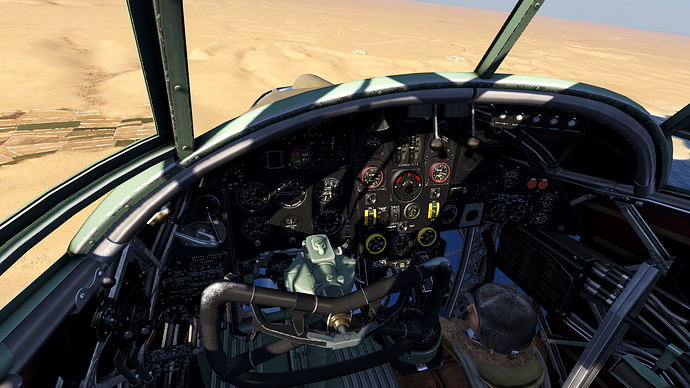 An in game screenshot of a Wellington bomber from the pilot position looking down at the instrument panel.