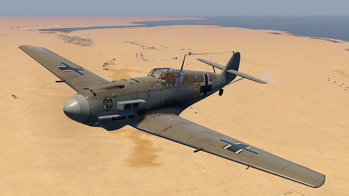 An in game screenshot of a Bf-109, external over the deserts of Africa.