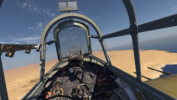 An in game screenshot of a Hurricane showing the pilot view and instrument panel.
