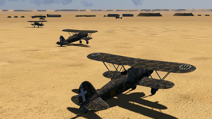 An in game screenshot of a number of Falco, external showing them at rest at a desert airfield.